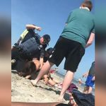 NJ officer seen punching woman in the head during arrest at popular beach; police investigate
