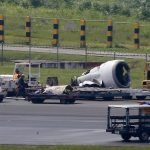 Chinese plane skids off Manila runway in downpour; all safe