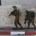 Israeli troops kill Palestinian after suspected car ramming