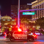 The Latest: Vegas police: Wounded robbery suspect has died