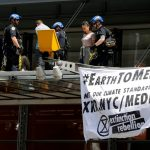 Climate change protesters cause disruption outside NYT