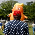 Antiwar group brings massive diaper-wearing Trump balloon to Washington Monument