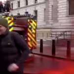 Climate Activists Trying to Spray Building With Fake Blood Lose Control of Hose