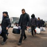 Ukraine, pro-Russian separatists swap prisoners in step to end 5-year war