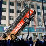 China sinkhole swallows bus, leaves at least 6 dead, several missing